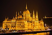 Hungarian Parlament building at night, Neogothic Style, National Assembly. Banks of Danube river. Budapest Hungary, Southeast Europe.