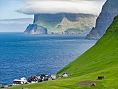 Island Kalsoy, village Trollanes, in background the island Kunoy and Vidoy. Nordoyggjar (Northern Isles) in the Faroe Islands, an archipelago in the north atlantic. Europe, Northern Europe, Scandinavia, Denmark, Faroe Islands.