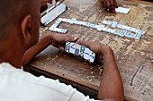 Men playing dominos in a street of Remedios, Cuba.