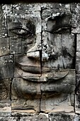 Carved stone head at Bayon temple,Angkor Wat,Cambodia,Indochina,Southeast Asia,Asia.