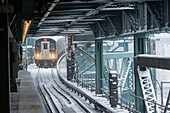 A Flushing Line train arrives at the Queensboro Plaza station in New York during the city's first major winter storm of the season. Meteorologists are forecasting between 8 and 14 inches of snow in the New York City region. The Metropolitan Transportation