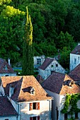 Evening sunlight over medieval town of Saint-Cirq-Lapopie, Midi-Pyrenees, France.