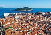 View from defensive Walls of Dubrovnik, Old Town of Dubrovnik city, Croatia, with Saint John Fortress on left and Lokrum Island.
