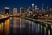 Philadelphia Skyline At Night - A view to the Philadelphia Skyline during the blue hour at twilight. The urban skyline shows the Comcast Building, One and Two Liberty Place, The PSFS building which is presently the Loews Hotel, the Aramark building, and t