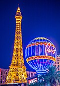 The Paris Las Vegas hotel and casino in Las Vegas. The hotel includes a half scale, 541-foot (165 m) tall replica of the Eiffel Tower.