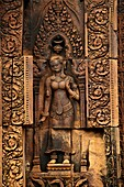 Devata carving, Banteay Srei temple, Angkor, Cambodia. The citadel of women, this temple contains the finest, most intricate carvings to be found in Angkor. 967 CE.
