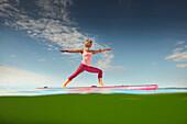 Yoga Teacher on SUP Board,  Lake Starnberg, Bavaria, Germany