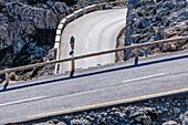 A cyclist on a winding road, Tramuntana Mountains, Mallorca, Spain
