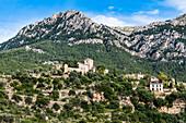 View at the village with church Parroquia San Juan Bautista, Deià, Tramuntana Mountains, Mallorca, Spain