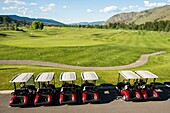 A row of golf carts at the Dunes golf course in Kamloops, BC, Canada.