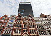 The skyscraper at 20 Fenchurch Street overhangs an victorian building in City of London, London, Great Britain, UK