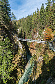 People walking on the walkway over Leutasch Spirit gorge. Mittenwald, Upper Bavaria, Bavaria, Germany.