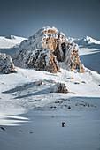 Solitary skialper below Monte Amaro in Maiella, Maiella, L'Aquila province, Abruzzo, Italy, Europe