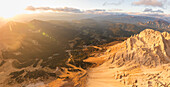 Panoramic aerial view of Latemar massif and Obereggen at sunset, Dolomites, South Tyrol, Italy