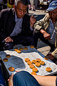 People playing in street of old town of Dali, Yunnan Province, China, Asia, Asian, East Asia, Far East