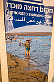 People enjoying the natural mineral mud sourced from the dead sea, North Dead Sea, West Bank, Palestine