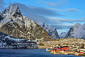 Fisherman´s cabins of Reine with mountains in background, Reine, Lofoten, Nordland, Norway