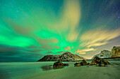 Beach with polar lights and stary sky, northern lights, aurora borealis, Lofoten, Nordland, Norway