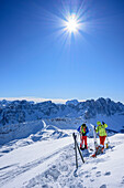 Two persons backcountry skiing standing at Peitlerkofel, Peitlerkofel, Natural Park Puez-Geisler, UNESCO world heritage site Dolomites, Dolomites, South Tyrol, Italy