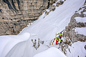 Two persons backcountry skiing ascending through canyon to Puezspitze, Puezspitze, Natural Park Puez-Geisler, UNESCO world heritage site Dolomites, Dolomites, South Tyrol, Italy