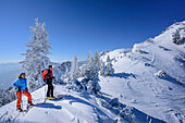 Two persons backcountry skiing standing at ridge of Wildalpjoch, Wildalpjoch, Bavarian Alps, Upper Bavaria, Bavaria, Germany