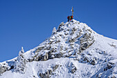 Three persons backcountry skiing standing at summit of Wildalpjoch, Wildalpjoch, Bavarian Alps, Upper Bavaria, Bavaria, Germany