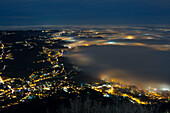 fog bank above Annone lake viewed from the top of Barro mount at dusk, Barro mount Regional Park, Lecco province, Lombardy, Italy