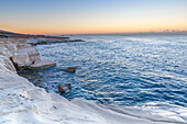 Cyprus, Limassol, The crystal water and the white rocks of Governor's Beach at dawn