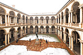 Courtyard of honor of the Palace of Brera during snowfall. Milan, Lombardy, Northern Italy, Italy.