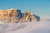 Alpe di Siusi/Seiser Alm, Dolomites, South Tyrol, Italy. The peaks of Sciliar/Schlern in the light of the sunrise