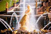 Golden statues of the fountain Grand Cascade of Peterhof, Saint Petersburg, Russia