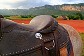 Detail of leatherwork and riding saddle and equipment during horse riding tour through tobacco fincas plantations in Vinales valley, western Cuba