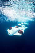 Photograph with prototype two-man personal submarine traveling underwater, Lake Tahoe, California, USA