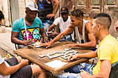 A group of men play dominos in the street of Havana, Cuba