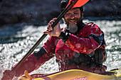 Close up of male kayaker smiling while kayaking on Snake River, Jackson Hole, Wyoming, USA