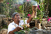 Local Shaman praying before his welcome ceremony at village near Cob, in Quintana Roo, Mexico