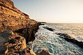 Scenery of clifftop footpath on seashore near Ajuy, Fuerteventura, Canary Islands, Spain