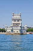 Fortified Belem Tower standing against clear sky on shore of Tagus river, Lisbon, Portugal