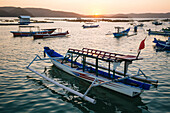 Lots of outrigger boats in sea at sunset, Kuta, Lombok, Indonesia