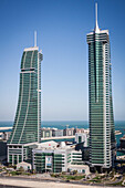 general shot of the glass towers of the bahrain financial harbour in the city center of manama, kingdom of bahrain, persian gulf, middle east