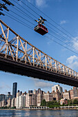 cabin of the roosevelt island aerial tramway over the east river and the queensboro bridge, cable car built by the french company poma, manhattan, new york city, new york, united states, usa