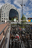 bicycle parking in front of the markthal rotterdam, covered market, gastronomic stroll, artistic curiosity, city center, rotterdam, holland, the netherlands.