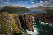 abrupt cliffs and sorvagsvatn lake above an agitated sea, leitisvatn, vagar, faroe islands, denmark
