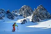 Woman backcountry-skiing ascending towards Zwiesel, Zwiesel, Chiemgau Alps, Chiemgau, Upper Bavaria, Bavaria, Germany