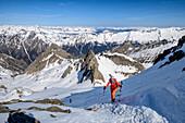 Woman backcountry-skiing ascending towards Wilde Kreuzspitze, Wilde Kreuzspitze, valley of Pfitschtal, Zillertal Alps, South Tyrol, Italy