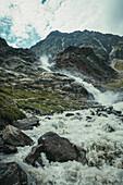 Waterfall in the rock massif with hiking group during the ascent, E5, Alpenüberquerung, 4th stage, Skihütte Zams,Pitztal,Lacheralm, Wenns, Gletscherstube, Zams to  Braunschweiger Hütte, tyrol, austria, Alps