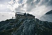 Climber photographs panorama on Braunschweiger hut, E5, Alpenüberquerung, 4th stage, Skihütte Zams,Pitztal,Lacheralm, Wenns, Gletscherstube, Zams to  Braunschweiger Hütte, tyrol, austria, Alps