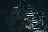 Signpost marking on rock wall with stone stairs in the background, E5, Alpenüberquerung, 5th stage, Braunschweiger Hütte,Ötztal, Rettenbachferner, Tiefenbachferner, Panoramaweg to Vent, tyrol, austria, Alps