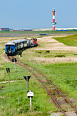 Island railway in front of the new lighthouse, Wangerooge, East Frisia, Lower Saxony, Germany