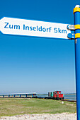 Island railway at the entrance to the harbour jetty, Wangerooge, East Frisia, Lower Saxony, Germany